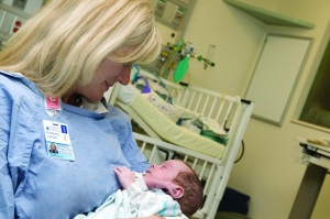 Kim Carson cuddles a preemie at UVA's Neonatal Intensive Care Unit