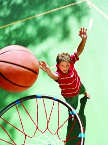Keep your kids fit, healthy by playing games together, like basketball.