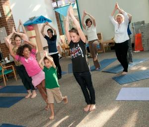 Children take a yoga class at UVA's Kluge Children's Rehabilitation Center
